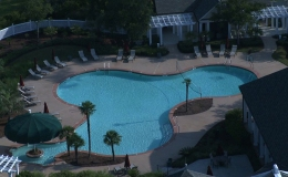 belfair-recreational-pool-with-in-pool-covered-seating-area