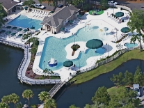 island-links-recreational-pool-water-play-features-wet-deck-spa-in-pool-covered-seating-area1